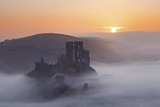 Mist below Corfe Castle at Sunrise, Dorset, England